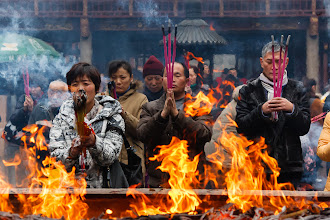 Photo: This is an image I took a couple of weeks ago, showing worshippers offering incense at City God Temple (Chenghuang Miao) in the old city area of Shanghai.  This was a fun photo to take. The flames are coming from a pit where people would throw the remains of their incense sticks. Every few minutes a man would come with a rake and give them a stir, at which point the flames would leap upwards for a few seconds. I'd then step forward, take a couple of shots before the flames died down (or my camera melted!). It took 3 or 4 attempts before I got this shot.  #FireFriday , curated by +Grayson Hartman