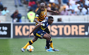 Thabo Nodada shields the ball from his marker during an Absa Premiership match.