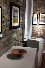 Photo: The art of Westen Muntain is on the walls to complement Phil's classic turned wood forms.