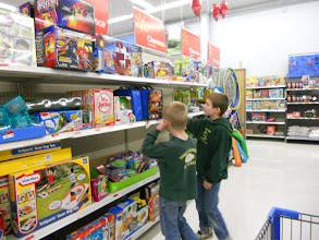 Photo: The boys took a little detour to check out the awesome clearance section. (I'm teaching them young to wait for a clearance sale)
