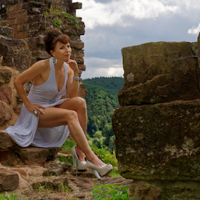 Big Bricks by Johannes Oehl - People Portraits of Women ( muscular, romanesque, dress, romance, castle, female hairstyle, 12th century, thigh, apparel, rheinland-pfalz, lower arm, upper-arm, looking at camera, building, frankenstein castle, leg, beautiful, up do, one female adult only, palatinate forest-north vosges biosphere reserve, rhineland-palatinate, place of interest, medieval architecture, wardrobe, female, shoulder, costume, ruin, brickwork, pfalz, upper leg, old, tree, german ethnicity, july, history, ancient, 11 brown iris, thin, spur castle, red sandstone, idyllic, person, outside, stone wall, forest, underarm, brick wall, germany, palatinate, martin-schultz scale, sandstone, 55-60 years, summer, romantic, unesco, brunette, lower leg, brick, europe, arm, architecture, 1 person, frankenstein, brunet, historic, middle ages, nature, sexy, biosphere reserve, medieval, brown eyes, necklace, blank expression, brown hair, clothes, dark mixed eyes, stone, outdoor, knee, jewellery, outdoors, hand on hip, dark age, fair skin, wall, summertime, sitting )