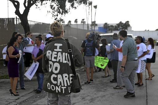 A woman protesting the detainment of undocumented immigrant children wears a jacket referencing Melania Trump during a demonstration outside a US border patrol processing centre in McAllen, Texas, on June 25 2018. Picture: REUTERS/LOREN ELLIOTT