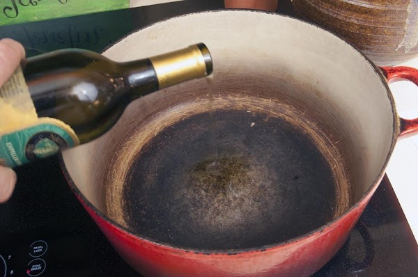Add the grapeseed oil to a large oven-ready pot (like a Dutch oven), over...