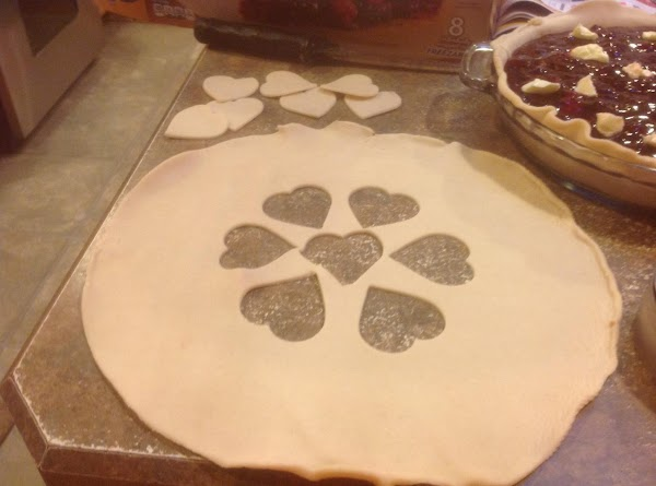 Now fold crust in half then fold a quarter  size, & place the...
