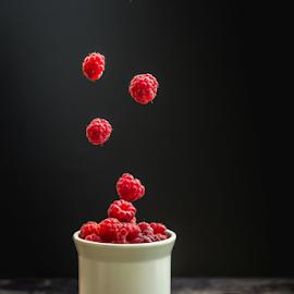 Flying raspberries by Marius Radu - Food & Drink Fruits & Vegetables ( fly, fruits, raspberyy, dark, food, cup,  )