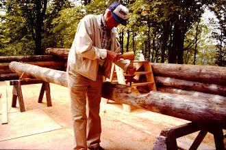 Photo: Irv Quam working a log.