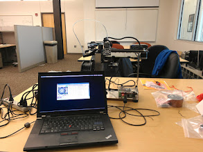 Photo: Wiggling it around from my laptop. The brick peeking out behind the screen is one of the two PSUs, a massive 12V 18A Dell power brick. Around this time, we learned that the geometry and drive means that if you cut motor power, the bed gently glides away to safety under gravity.