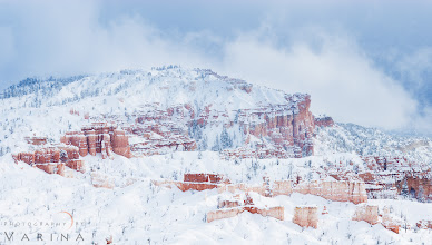 Photo: Snowfall at Bryce Canyon  I took this shot in 2007 - but just processed it this morning. It's always interesting to go back and process images from a few years ago.  When I opened this shot in Camera RAW, I knew exactly what I needed to do. I cropped it. Why? Because there were dark trees scattered in the foreground. As lovely as they were, they drew my eye away from the main elements. They were a distraction. If I had taken this photo today, I wouldn't have included those trees in the photo in the first place. My style has changed over time... or perhaps it is just more defined. I've always appreciated simple compositions - but over time, my simple compositions have become minimalist compositions. I find that when it comes to my own photography, I almost always prefer extreme simplicity.  Of course, I made a few other changes as well. I corrected the color balance so that the snow felt clean and fresh. I darkened the sky just a bit to even out the exposure and bring out that pretty blue. And I adjusted the contrast to ensure that the details in the sandstone were crisp.  This photo was featured Photo Extract's Top Ten Photos for December 1st with +Jarek Klimek: http://www.photoextract.com/plus-extract/2012/12/4  Thanks so much!