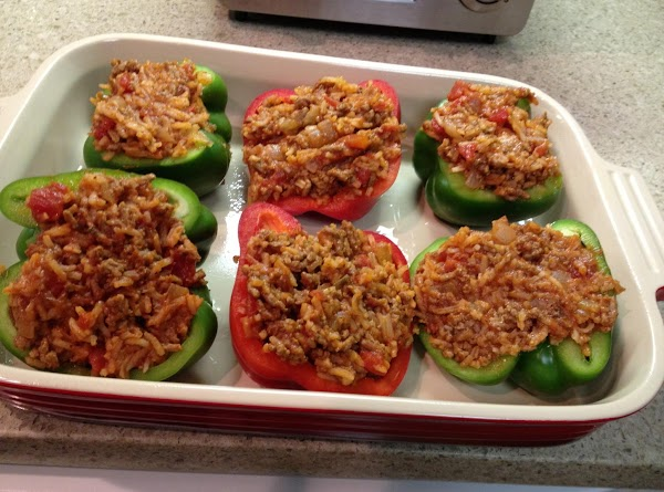 Fill peppers and spoon the remaining rotel over the filling.  Cover back up...