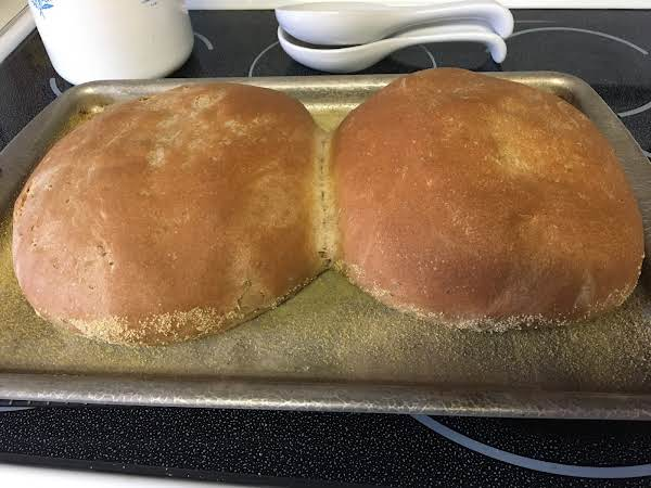 The Loaves Are Baked And Ready To Cool On A Wire Rack.