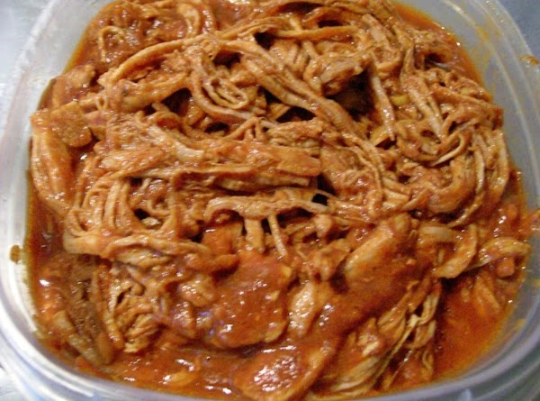 Pour sauce from the slow cooker into a seperate bowl.Place Pork back into Slow...