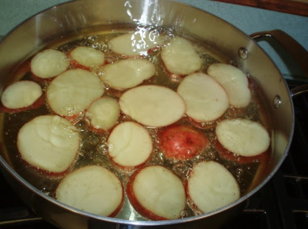 Fry potato slices in vegetable oil until golden & tender; drain paper toweling and...