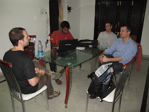 Photo: SciPy India 2010: back at the hotel where the internet connectivity was excellent and unfiltered. Nishanth Amuluru working on some IPython code. Jarrod Millman (left), Stefan and Jonh Hunter (right).