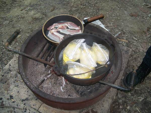 The Bags Boiling In The Dutch Oven Over The Fire