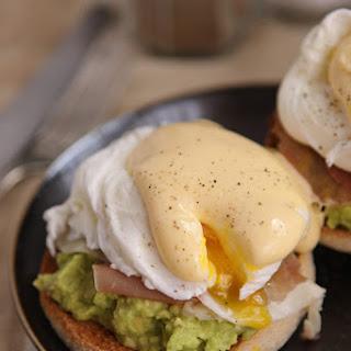 Avocado & Parma ham eggs Benedict with Hollandaise.