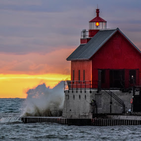 Grand Haven. by Darrin Ralph - Buildings & Architecture Public & Historical ( water, red, lake michigan, sunset, waves, lighthouse, fishing )