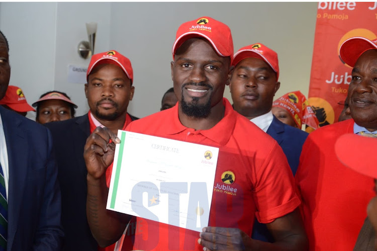Kibra Jubliee candidate McDonald Mariga with his nomination certificate on September 10, 2019.