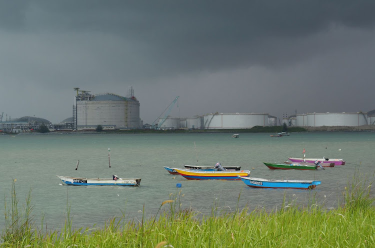 Boats float in front of the Vopak oil storage terminal in Johor, Malaysia. Picture: REUTERS/HENNING GLOYSTEIN
