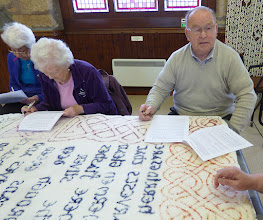 Photo: Completing evaluation forms for the main funding body - Heritage Lottery Fund