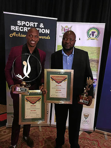 Long jump star Luvo Manyonga and Eastern Cape boxing promoter Ayanda Matiti pose with their awards. / Supplied