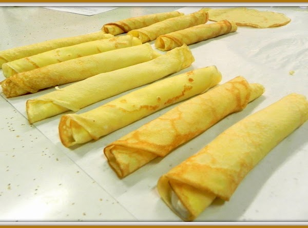 Roll up crepes and fry lightly in butter.
