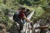 Indonesia. Papua Baliem Valley Trekking. Narrow wood log bridge to Sobaham