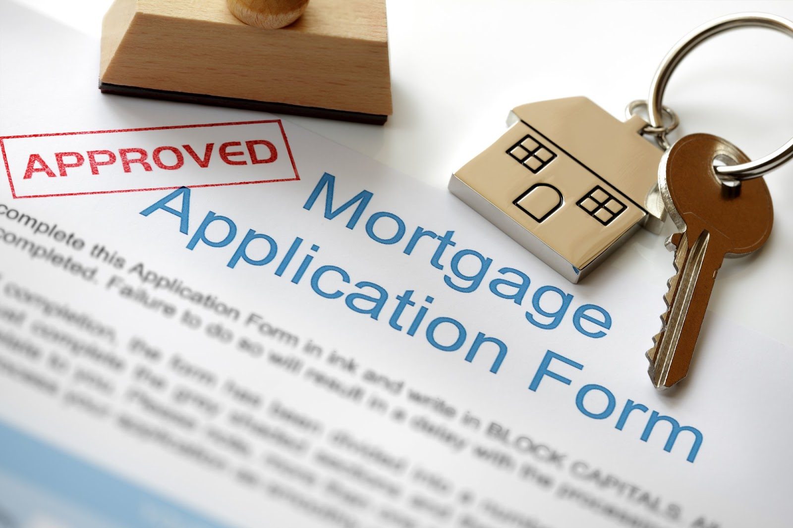 Approved mortgage application with keys on the paperwork