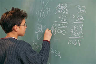 Photo: Performing Math Calculations at Chalkboard