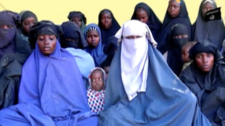 Teenage girls said to be part of the group who were kidnapped from the northeast Nigerian town of Chibok are seen in an unknown location in Nigeria in this still image taken from an undated video, obtained on January 15 2018. Picture: REUTERS