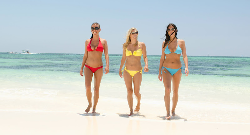 You can bet these gals are wearing sunscreen during their beach walk on Grand Bahama Island.