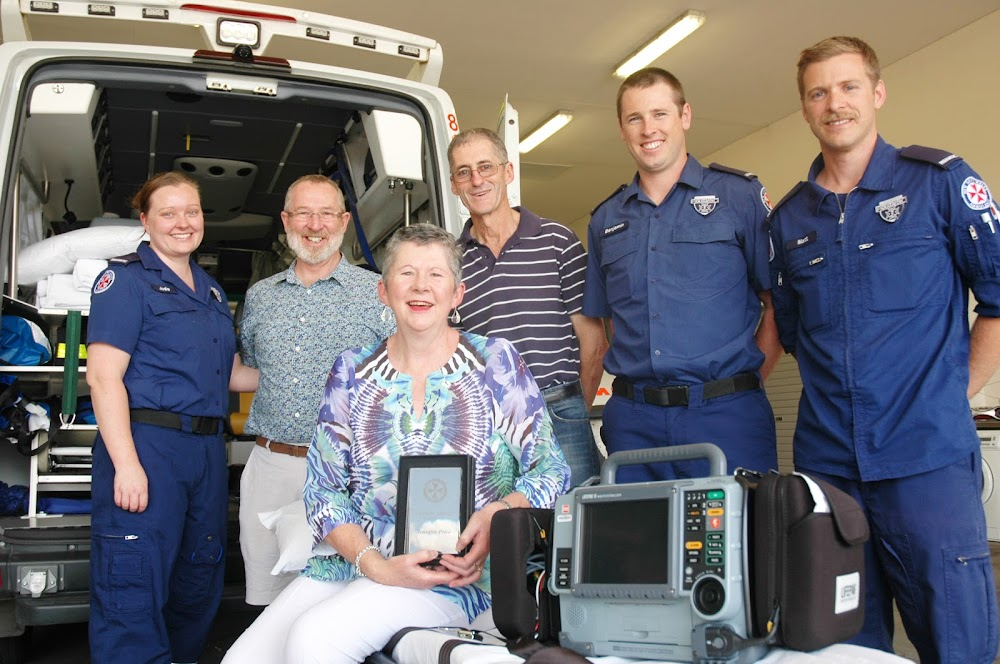 LIFESAVERS: Jenny Price, front, with husband Peter and brother-in-law Howard McFetridge behind her along with three Narrabri ambulance paramedics who helped her survivie a cardiac arrest - Jodie Knights, Ben Maddern and Matt Chapman. Wee Waa-based paramedics Harry Richards and Lisa Snell, not in this photo, also played their part.