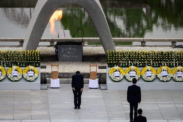 Prime Minister Shinzo Abe of Japan bowing in front of the Memorial Cenotaph after delivering a speech during the 75th anniversary service for atomic bomb victims at the Peace Memorial Park in Hiroshima on Thursday.