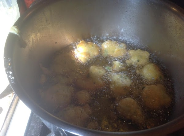 Heat oil in a large skillet or pot to about 375 degrees F. Then...