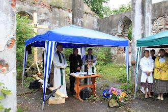 Photo: Bishop Kugappi and others lead worship in the rain.