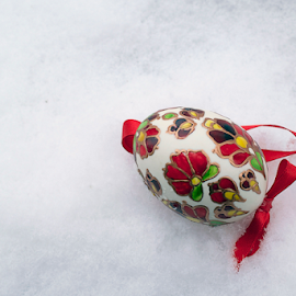 beautiful colorful easter egg on the snow by LADOCKi Elvira - Public Holidays Easter ( holiday, eggs, easter, easter decoration, colorful, decoration, easter eggs )