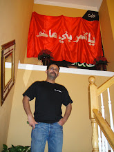 Photo: Dr. Sami at Ali Rizvi's residence under piece of Hazrat Abbas Ghazi's flag once raised at His Roza-e-Mubarrak.