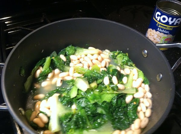 ADD CANNELLINI  BEANS (WITH LIQUID DO NOT DRAIN) N PARSLEY THEN TURN HEAT...