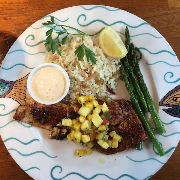 GF Blackened Red Snapper with Mango Salsa, jasmine rice with almonds and raisins and asparagus.