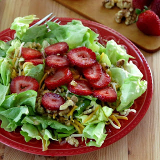 Red Wine Vinaigrette Dressing over Salad Greens and Strawberries
