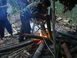 Photo: Bamboo cooking from local guide on 3 days trek in Nam Ha Forest camp