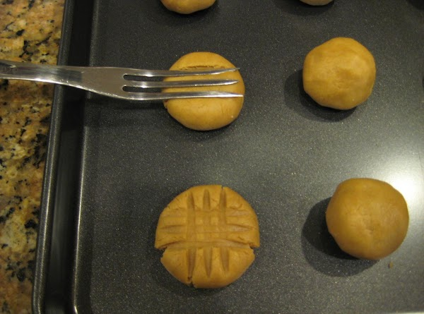 """Shape into 1 1/2"""" balls, place on cookie sheet and press down with large..."""