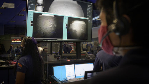 Members of NASA's Perseverance Mars rover team watch in mission control as the first images arrive moments after the spacecraft successfully touched down on Mars. (Source: NASA/Bill Ingalls)