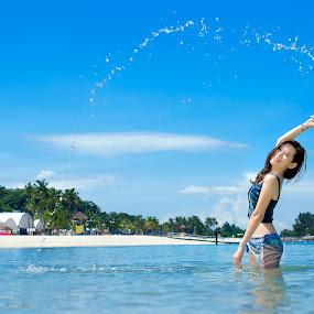 The Summer Girl by Gary Kuen - People Portraits of Women ( blue sky, water spreading, summer, sentosa, beach, motion, singapore, beautiful girl )