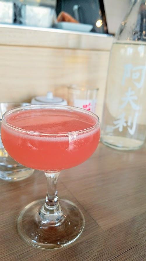 Afuri PDX Sakura Pink Blossom cocktail with Altos Reposado tequila, rhubarb, lemon, Cointreau, Peychaud's