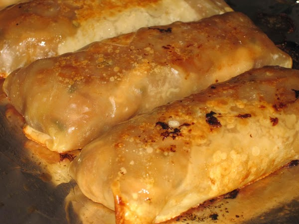 Flip egg rolls carefully with a spatula and spoon, add a bit more egg...