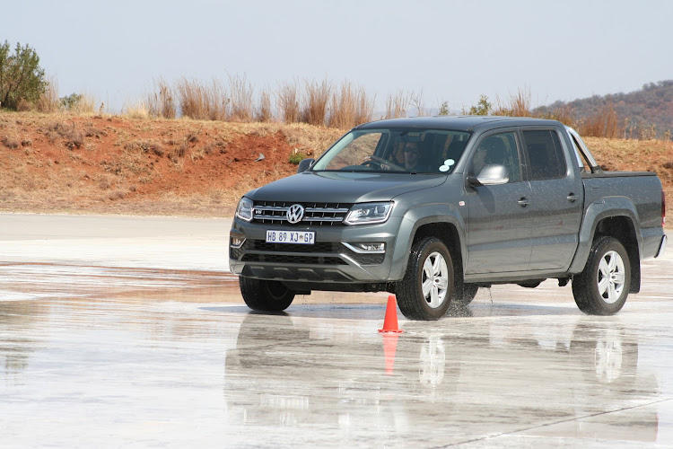 The driving test took the form of a skidpan gymkhana and participants were rated on their technical skills and reaction times. Picture: DENIS DROPPA