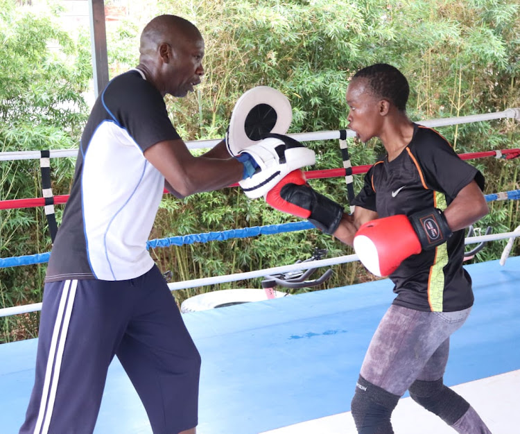 Hit Squad assistant coach Dave Munuhe guides Tokyo-bound Christine Ongare during a past training session. IMAGE: COURTESY