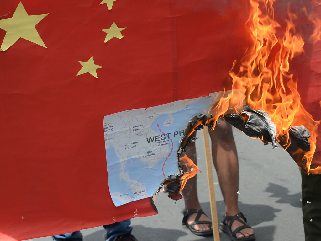 Activists burn a Chinese Communist Party flag with a map of the South China sea during a protest in front of the Chinese Consulate in Manila on June 12, 2019. Citizens of many Southeast Asian countries are concerned about increasing bullying and influence by the Party in the region. The Quad Summit was intended to address this issue under the Trump and Pompeo administrations.