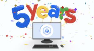 5 years celebration text hanging over a desktop computer