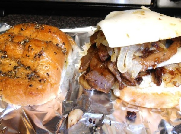 set your oven on broil (high). brush the tops of your bread with olive...